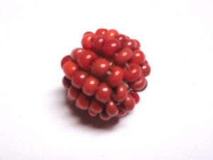 Bead made of seed beads red opal