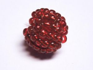 Bead made of seed beads red with silver foil