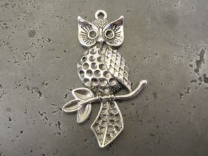 Pendant owl on a branch