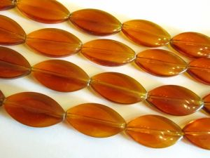 Glass bead oval amber