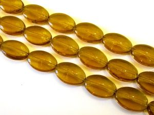 Glass bead oval coin light amber