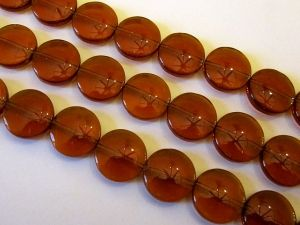 Glass bead coin dark amber
