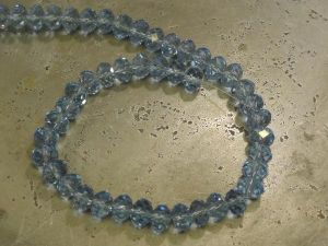 Crystal rondelle 3x4mm light blue KRR0007