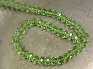 Crystal rondelle 4x6mm light green KRR0052