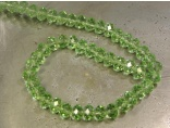 Crystal rondelle 3x4mm light green KRR0013
